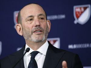 FILE - In this April 18, 2019 file photo Major League Soccer Commissioner Don Garber speaks at a news conference in Los Angeles. Garber and MLSPA executive director Bob Foose are embroiled in a public spat over amending the current collective bargaining agreement after the league invoked the force majeure clause.