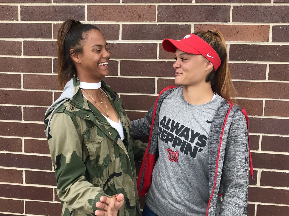 West High's Keisha White, left, and Brianna White, right, compete together on the school's basketball, track and softball teams. They hope to repeat this spring as state champs in softball.