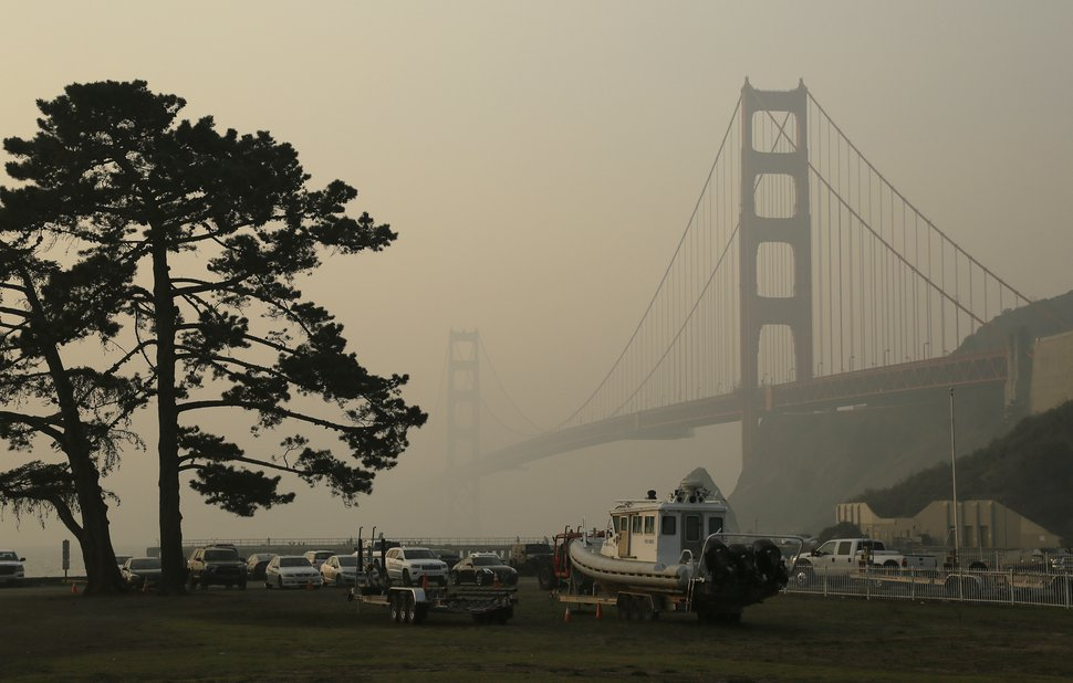 (Eric Risberg | AP file photo) In this 2018 photo, the Golden Gate Bridge is obscured by smoke and haze from wildfires in this view from Fort Baker near Sausalito, Calif.