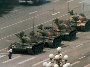 FILE - In this June 5, 1989, file photo, a Chinese man stands alone to block a line of tanks heading east on Beijing's Cangan Blvd. in Tiananmen Square. The man, calling for an end to the recent violence and bloodshed against pro-democracy demonstrators, was pulled away by bystanders, and the tanks continued on their way. Thousands of students demonstrated for democracy in Tiananmen Square. Hundreds died when the government sent in troops. (AP Photo/Jeff Widener, File)
