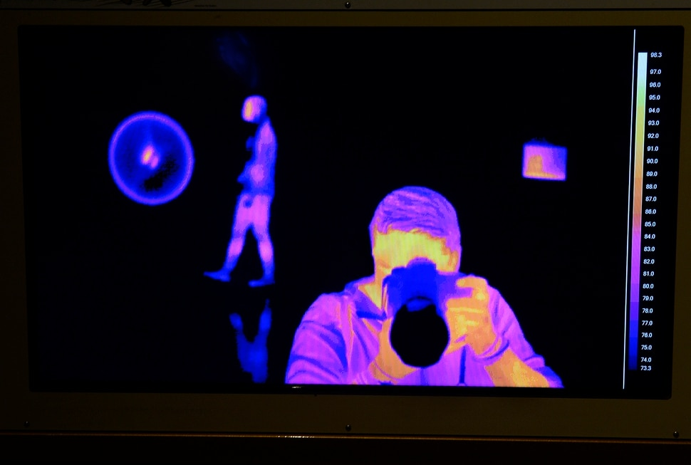 (Scott Sommerdorf | The Salt Lake Tribune) An exhibit about maintaining body heat shows the photographer in an infrared image at the Utah Museum of Natural History, Wednesday, Feb., 7, 2018. Nature's Ultimate Machines is the UMNH special exhibition exploring the workings of plants and animals and how they rely on finely-tuned natural devices to move, adapt and survive.