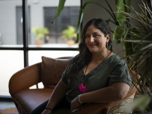 (Emil Lippe   The New York Times) Veronica Garza, a co-founder with her mother and brother of Siete Family Foods, in Austin, Texas, on Aug. 14, 2021. Growing companies like Siete have struggled to find ways to make new hires feel theyÕre a part of the business when they canÕt meet in person.