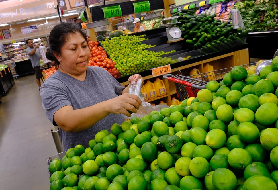 (Francisco Kjolseth | The Salt Lake Tribune) Isela Martinez who likes shopping on days with store deals, pics out limes on Wed. June 20, 2018, at Rancho Market at North Temple and 900 West, a chain that started in 2006 and now has 10 stores. The owner says half of their shoppers are Latino, and it caters to other immigrant groups and long-time residents. New Census numbers show a continuing growth of minorities in Utah. Minorities have grown by 132k since the 2010 Census in Utah, and the Latino population has grown by 76k since then.
