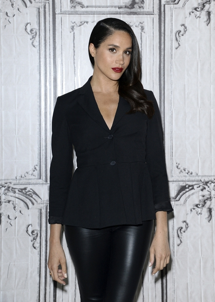 FILE - In this March 17, 2016 file photo, actress Meghan Markle participates in AOL's BUILD Speaker Series to discuss her role on the television show, Suits, at AOL Studios in New York. Palace officials announced Monday Nov. 27, 2017, Britain's Prince Harry and Meghan Markle are engaged, and will marry in the spring. (Photo by Evan Agostini/Invision/AP, File)