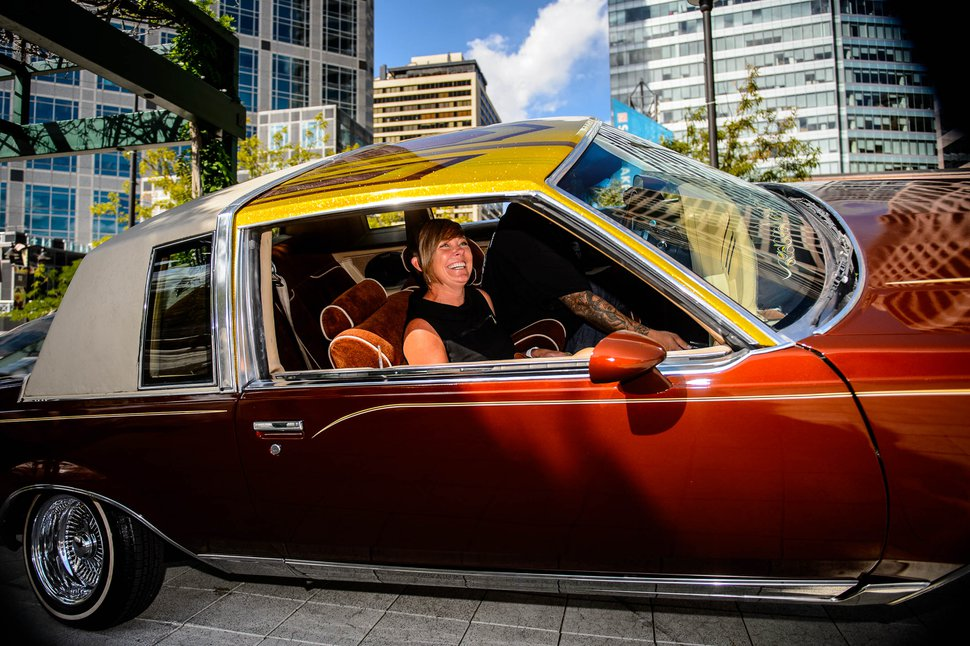(Trent Nelson | The Salt Lake Tribune) Salt Lake City Councilwoman Amy Fowler gets a ride from Freddy Alvarez in his 1982 Buick Regal after a news conference announcing the lineup of the upcoming 2019 Urban Arts Festival in Salt Lake City on Tuesday Sept. 10, 2019.