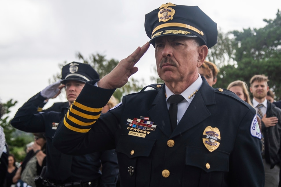 (Ben Dorger/Standard-Examiner via AP) Ogden Police Chief Randy Watt salutes at Officer Nate Lyday's burial service at Lindquist's Memorial Gardens of the Wasatch cemetery on Saturday, June 6, 2020, in Ogden, Utah. The 24-year-old officer was killed in the line of duty Thursday, May 28, when responding to a domestic violence call.