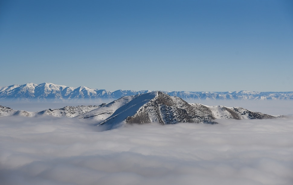 (Francisco Kjolseth | The Salt Lake Tribune) The Promontory Mountains and the Wasatch Range beyond push through the deteriorating air quality under inversion conditions on Monday, Jan. 14, 2019, obscuring the ground below as pilot Jeff Greenland takes every opportunity to fly above the poor conditions. Over the radio with Salt Lake Approach before landing he can be heard saying thanks for keeping us all safe during the shutdown, as the longest government shutdown in U.S. history drags on.