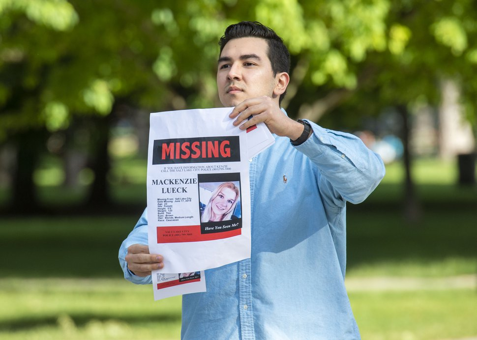 (Rick Egan | The Salt Lake Tribune) At Liberty Park, Nate Crispo holds a sign with the photo of Mackenzie Lueck. Lueck is missing since Monday. Saturday, June 22, 2019.