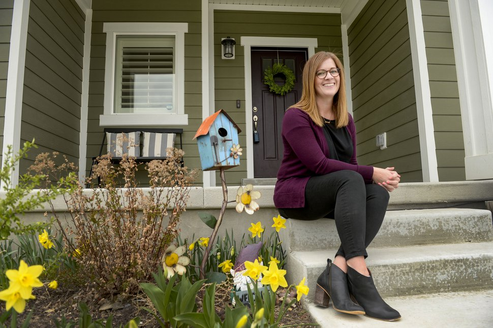 (Leah Hogsten | The Salt Lake Tribune) Realtor Alicia Holdaway sits outside one of her home listings in Riverton. Holdaway has been using social media phone apps like Facebook Live and Marco Polo to show potential buyers a 360-video tour of each of her home listings in Utah and out of state.