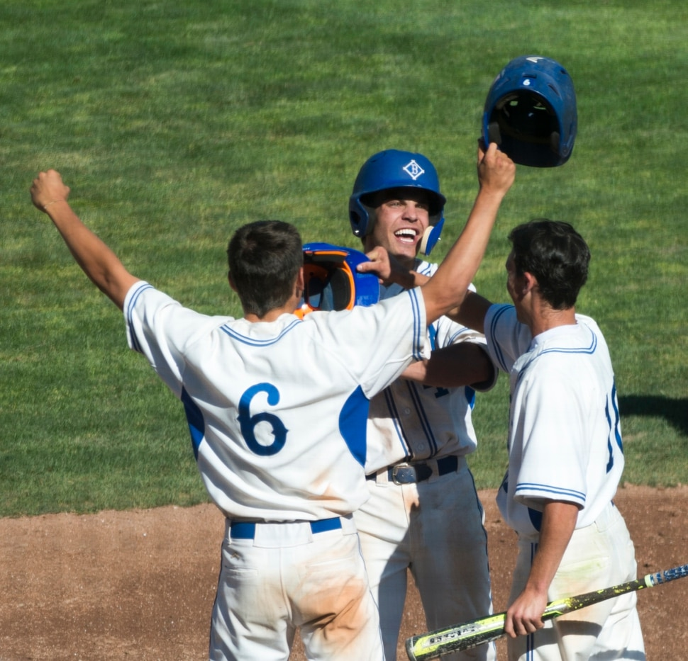 (Rick Egan | The Salt Lake Tribune) The Bingham Miners Tyler Kemp (6) and Nick Stevens (10) celebrate a 3-run homer by Noah Wallick (4), in 6A state baseball State Championship game, at UVU in Orem, Friday, May 25, 2018.