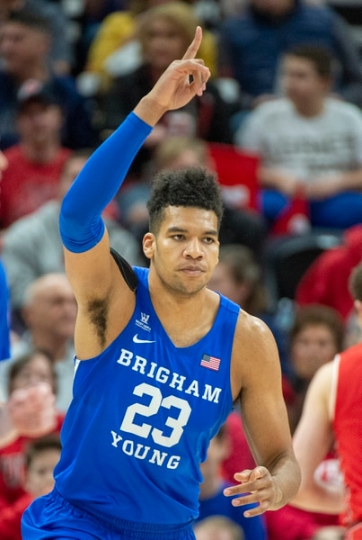 (Rick Egan | The Salt Lake Tribune) Brigham Young Cougars forward Yoeli Childs (23) celebrates after scoring 2 of his 15 first half points, in basketball action in the Beehive Classic, between against the Brigham Young Cougars and Utah Utes, at the Vivint Smart Home Arena, Saturday December 8, 2018.