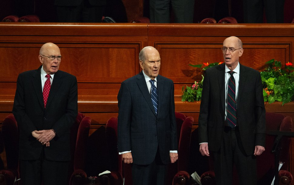 (Keith Johnson | Special to The Tribune) Left to right: President Dallin H. Oaks, President Russell M. Nelson and President Henry B. Eyring join The Tabernacle Choir at Temple Square, other church leaders and the congregation and sing a hymn during the 188th Semiannual General Conference of The Church of Jesus Christ of Latter-day Saints on Oct. 7, 2018, in Salt Lake City.