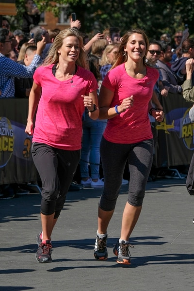 "(Photo courtesy of Timothy Kuratek/CBS) Skiers Kristi Leskinen (left) and Utahn Jen Hudak make their way to the starting line in the iconic Washington Square Park in New York City in the premiere of the 30th season of ""The Amazing Race"" on Wednesday, Jan. 3, at 7 p.m. on CBS/Ch. 2."