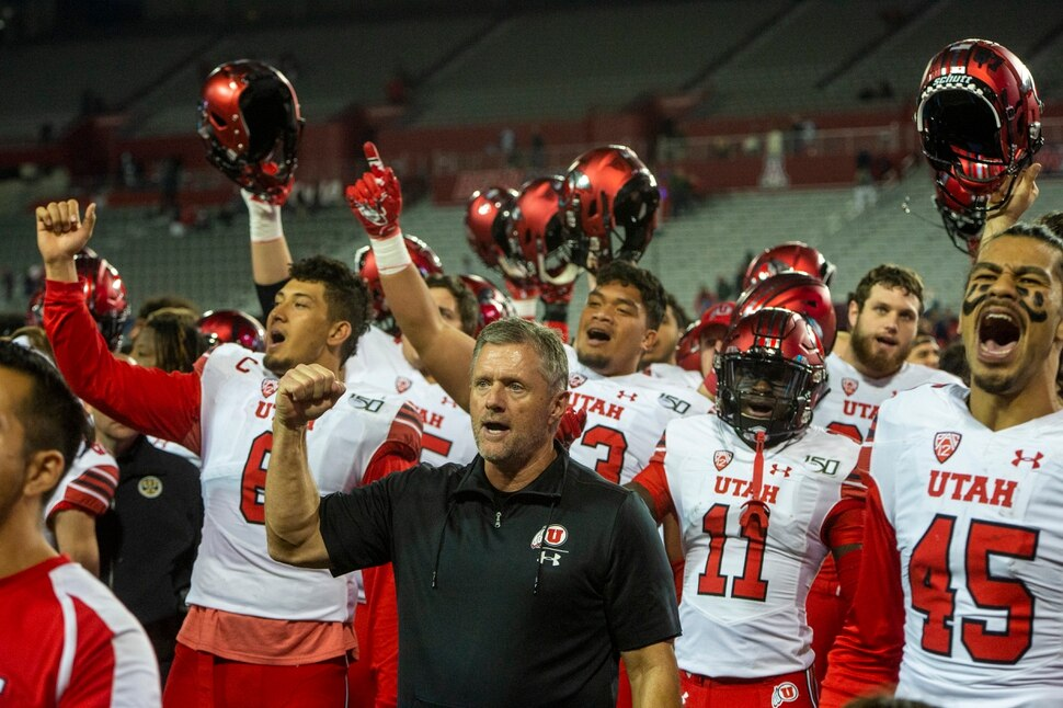 (Rick Egan | The Salt Lake Tribune) Utah Utes head coach Kyle Whittingham sings with his team after they defeated the Wildcats, 35-7, in PAC-12 action between the Utah Utes and the Arizona Wildcats in Tucson, Saturday, Nov. 23, 2019.