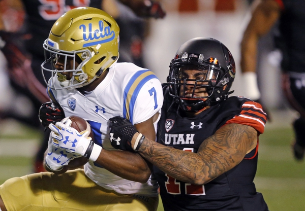 Utah defensive end Kylie Fitts (11) tackles UCLA wide receiver Darren Andrews (7) during the first half of an NCAA college football game Friday, Nov. 3, 2017, in Salt Lake City. (AP Photo/Rick Bowmer)