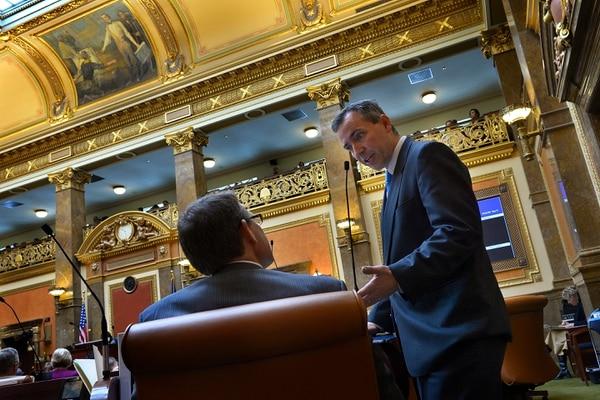 Scott Sommerdorf | The Salt Lake Tribune Rep. Dan McCay, R-Riverton, speaks with Rep. Brad Last, R-Hurricane, on the floor of the House of Representatives, Thursday, Feb. 6, 2014.