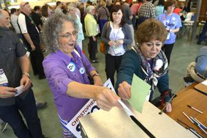 (Leah Hogsten  |  Tribune file photo) l-r Carol Evans of Taylorsville and Jan Ferre of Salt Lake City cast their ballots for candidates at the Salt Lake County Democratic convention, Saturday, April 12, 2014, at West Jordan Middle School.