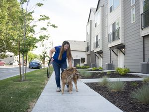 (Briana Scroggins | Special to The Tribune) Kristen Taylor walks her dog, Kara, outside of their apartment in South Salt Lake on Wednesday, June 16, 2021. Her landlord recently paid for a DNA test for Kara. More housing complexes are requiring such tests to prevent pet-owning tenants from leaving droppings on the property — or to bust them when they do.