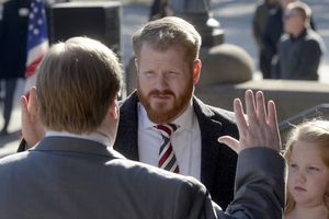 (Al Hartmann  |  The Salt Lake Tribune)  City Council member James Rogers takes the oath of office in ceremony outside City Hall in this file photo.  His daughter, Sadie, right. Rogers is stepping down from the council.