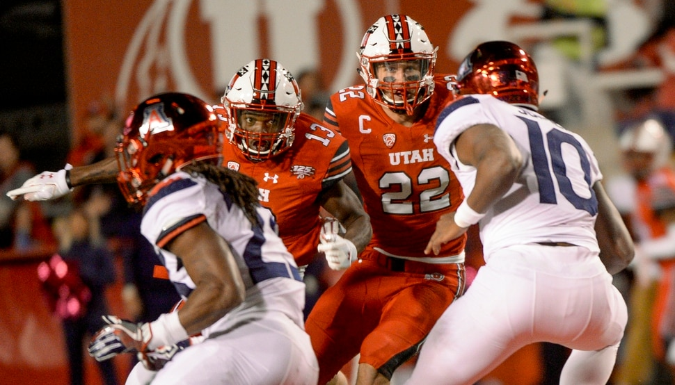 Leah Hogsten | The Salt Lake Tribune Utes linebacker Chase Hansen (22) and Utes defensive back Marquise Blair (13) looks to tackle Arizona Wildcats quarterback Jamarye Joiner (10)as the University of Utah hosts the Arizona Wildcats at Rice-Eccles Stadium in Salt Lake City, Friday Oct. 12, 2018.