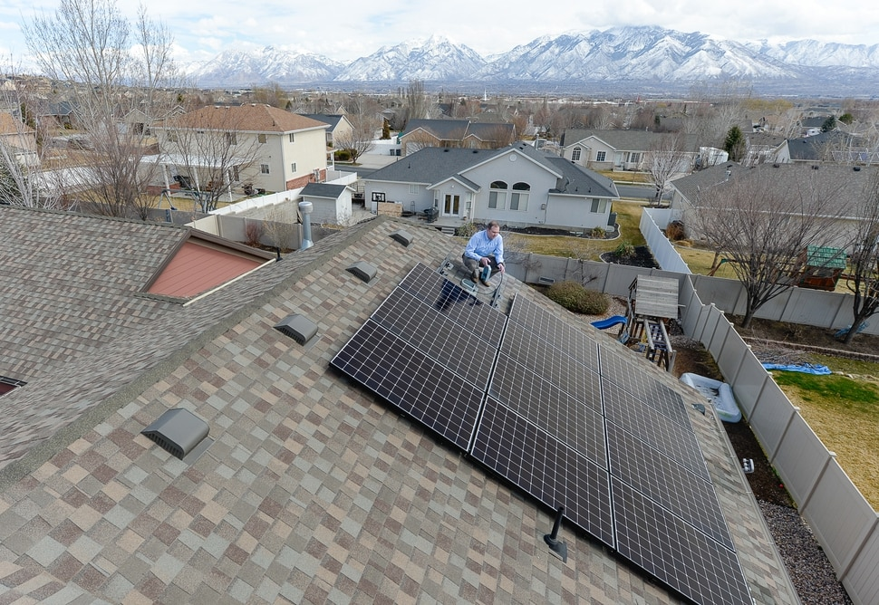 (Francisco Kjolseth | The Salt Lake Tribune) Doug McAllister of South Jordan bought a solar panel array from Legend Solar last September. In December, Legend Solar started putting the panels but never finished. McAllister owes more than $12,000 on a loan he took out to finance the panels. The company has indicated to him that they are unable to hire an electrician to finish the job and the array sits idle on his roof, two panels short and unconnected.