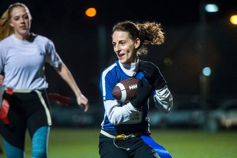 (Chris Detrick | The Salt Lake Tribune) Team A Lot's Leslie Hadfield runs the ball during the flag football team game against Sim Team at North University Fields in Provo Thursday, November 30, 2017.