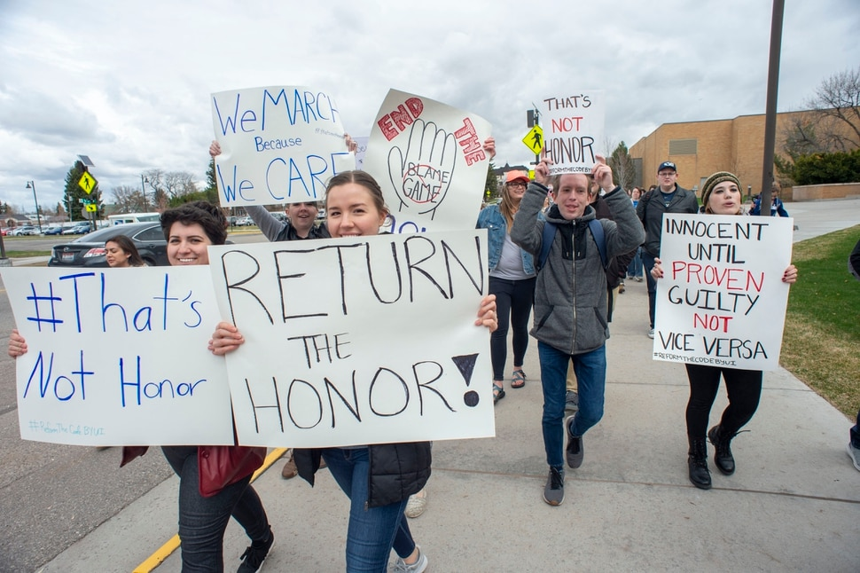 (Rick Egan | The Salt Lake Tribune) BYU Idaho students chant and hold signs tas hey protest for changes in the honor code at BYU Idaho in Rexburg, ID, Wednesday, April 10, 2019.