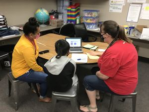 ( Julie Hirschi | Special to The Tribune )  Hillsdale Elementary School teacher Monica Cheshire, right, meets with Kyle, a 5th grader who is learning online, and his mother. Kyle asked to only be identified by his first name to protect his educational privacy.