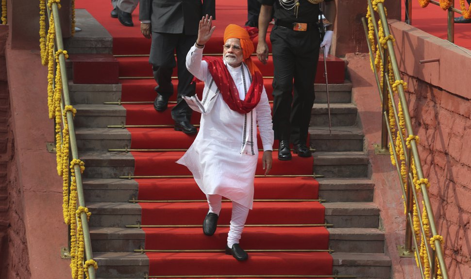 Indian Prime Minister Narendra Modi waves as he leaves after addressing the nation on the country's Independence Day from the ramparts of the historical Red Fort in New Delhi, India, Wednesday, Aug. 15, 2018. India won independence from British colonialists in 1947. (AP Photo/Manish Swarup)