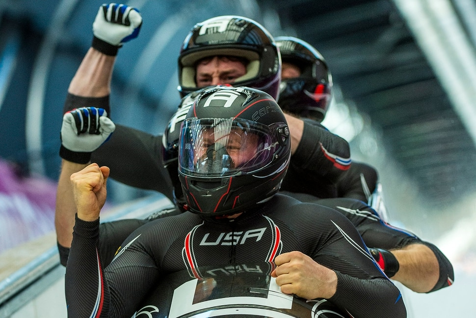 KRASNAYA POLYANA, RUSSIA - JANUARY 23: Night Train 2, piloted by Steven Holcomb and pushed by Chris Fogt, Curtis Tomasevicz, Steve Langton, celebrate at the finish of the four-man bobsled at Sanki Sliding Center during the 2014 Sochi Olympics Sunday February 23, 2014. The team won the bronze medal with a cumulative time of 3:40.99. (Photo by Chris Detrick/The Salt Lake Tribune)