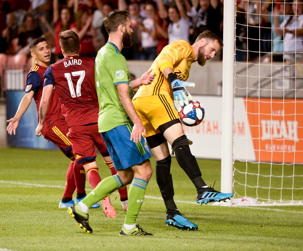 (Leah Hogsten | The Salt Lake Tribune) Real Salt Lake forward Corey Baird (17) kicks in the team's third goal on Seattle Sounders goalkeeper Stefan Frei (24) as Real Salt Lake hosts the Seattle Sounders, Aug. 14, 2019, at Rio Tinto Stadium in Sandy. RSL defeated the Sounders 3-0.