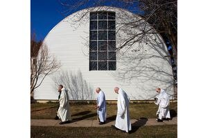 (Steve Griffin | The Salt Lake Tribune) Monks walk back to the monastery at Holy Trinity Abbey in Huntsville in 2010. Salt Lake City attorney Michael O'Brien has a new book about his family's many visits to the Trappist monastery in northern Utah and his life among Catholic monks and Latter-day Saints.