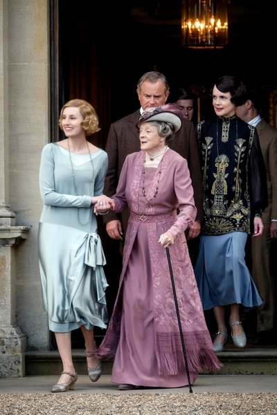 This image released by Focus features shows, from left, Laura Carmichael as Lady Hexham, Maggie Smith as The Dowager Countess of Grantham, Hugh Bonneville as Lord Grantham, Allen Leech as Tom Branson and Elizabeth McGovern as Lady Grantham in a scene from Downton Abbey. The highly-anticipated film continuation of the Masterpiece series that wowed audiences for six seasons, will be released Sept. 13, 2019, in the United Kingdom and on Sept. 20 in the United States. (Jaap Buitendijk/Focus Features via AP)