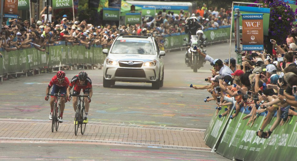 Rick Egan | The Salt Lake Tribune Lachlan Norris and Brent Bookwalter are neck and neck on the final climb up Park City's Main Street, in Tour of Utah Stage 7, competition Sunday, August 9, 2015. Norris edged out Bookwalter to win the stage.