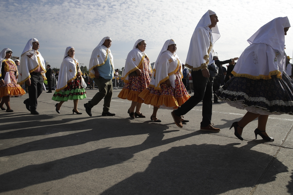 People in traditional dress arrive for a Mass celebrated by Pope Francis at O'Higgins Park in Santiago, Chile, Tuesday, Jan. 16, 2018. (AP Photo/Alessandra Tarantino)