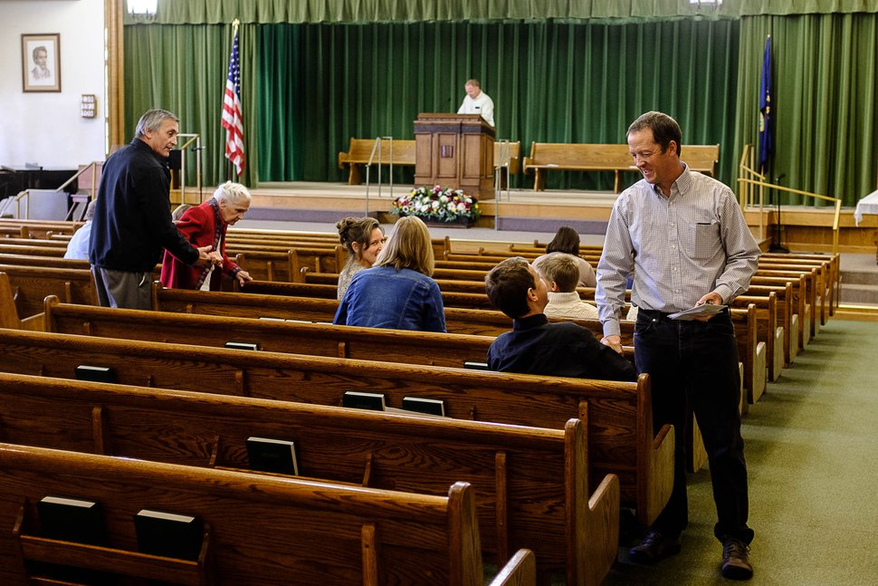 (Trent Nelson | The Salt Lake Tribune) Lex Herbert, Bishop of the Second Ward, shakes a youth's hand before the start of Sacrament Meeting for the Pinesdale Second Ward, in Pinesdale, Mont.