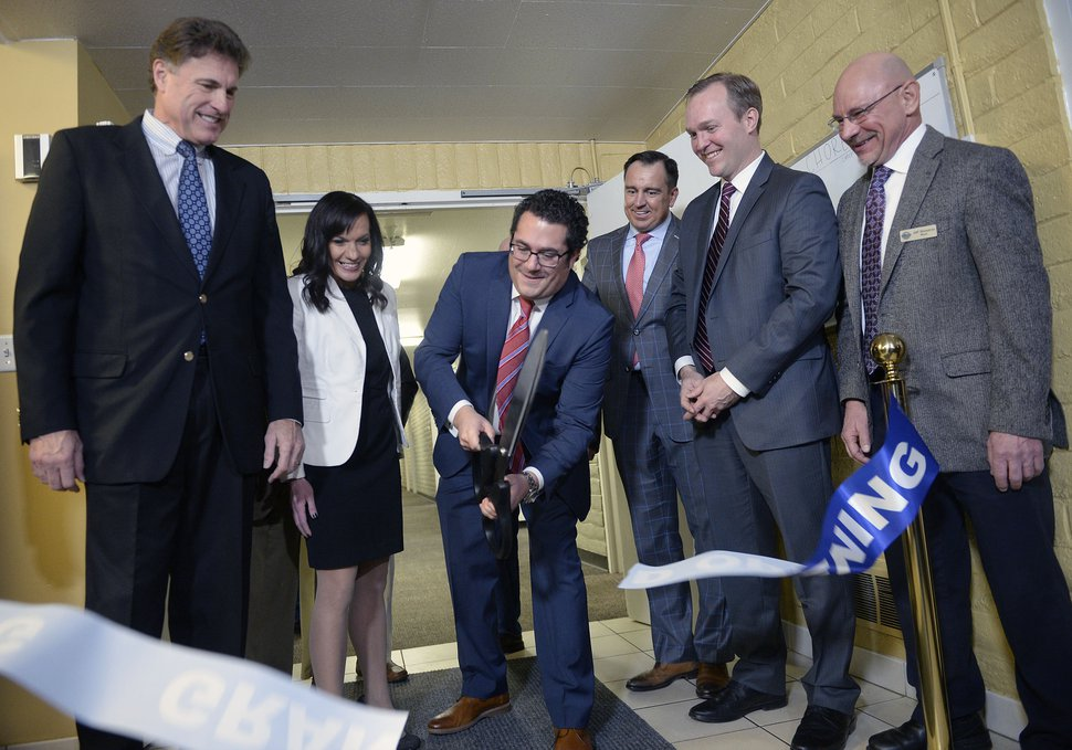 (Al Hartmann | The Salt Lake Tribune) Rep. James Dunnigan, left, Odyssey House outreach specialist Rachel Santizo, Odyssey House CEO Adam Cohen, Speaker of the House Greg Hughes, Salt Lake County Mayor Ben McAdams and Milcreek Mayor Jeff Silvestrini cut the ribbon to open a new Odyssey House- an 83 bed treatment facility Thursday Jan. 11 at 3944 S. 400 E. in Millcreek.