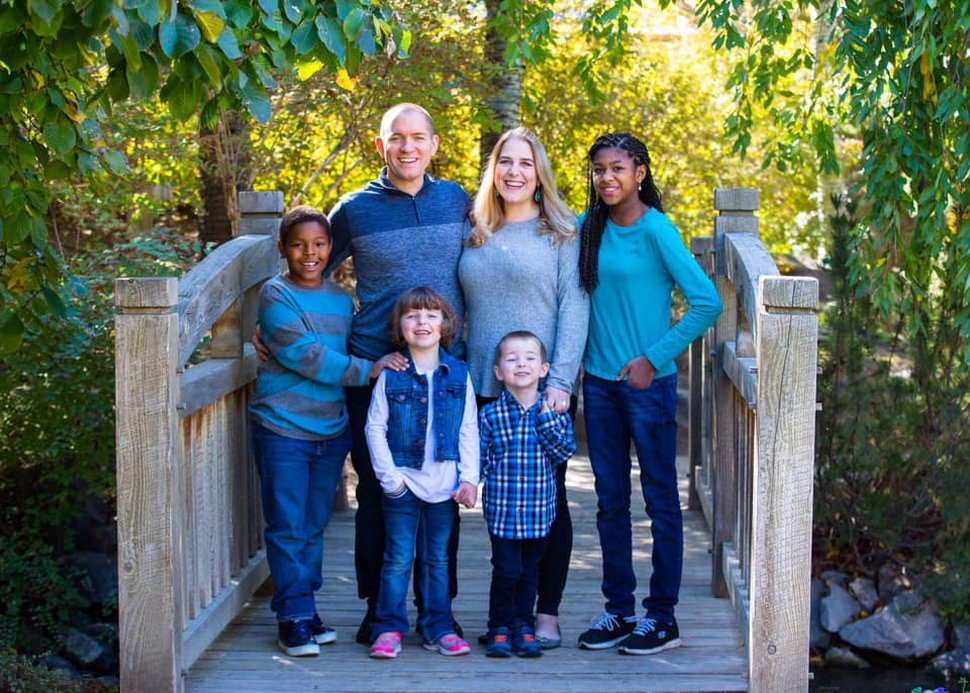 (Photo courtesy of FotoFly/Budworth family) In this photo, parents Shannon and Mac Budworth pose with their four kids.