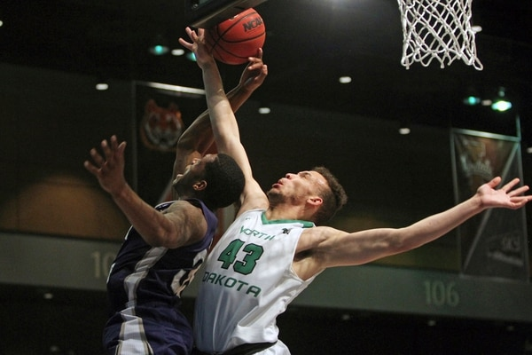 North Dakota forward Drick Bernstine (43) shoots in front of Weber State forward Kyndahl Hill (35) during the first half an NCAA college basketball game in the finals of the Big Sky tournament in Reno, Nev., Saturday, March 11, 2017. (AP Photo/Lance Iversen)