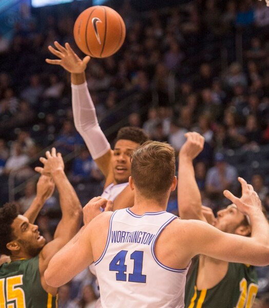 (Rick Egan | The Salt Lake Tribune) Brigham Young Cougars forward Yoeli Childs (23) tosses a pass to Brigham Young Cougars forward Luke Worthington (41) in basketball action at the Marriott Center, Saturday, February 10, 2018.