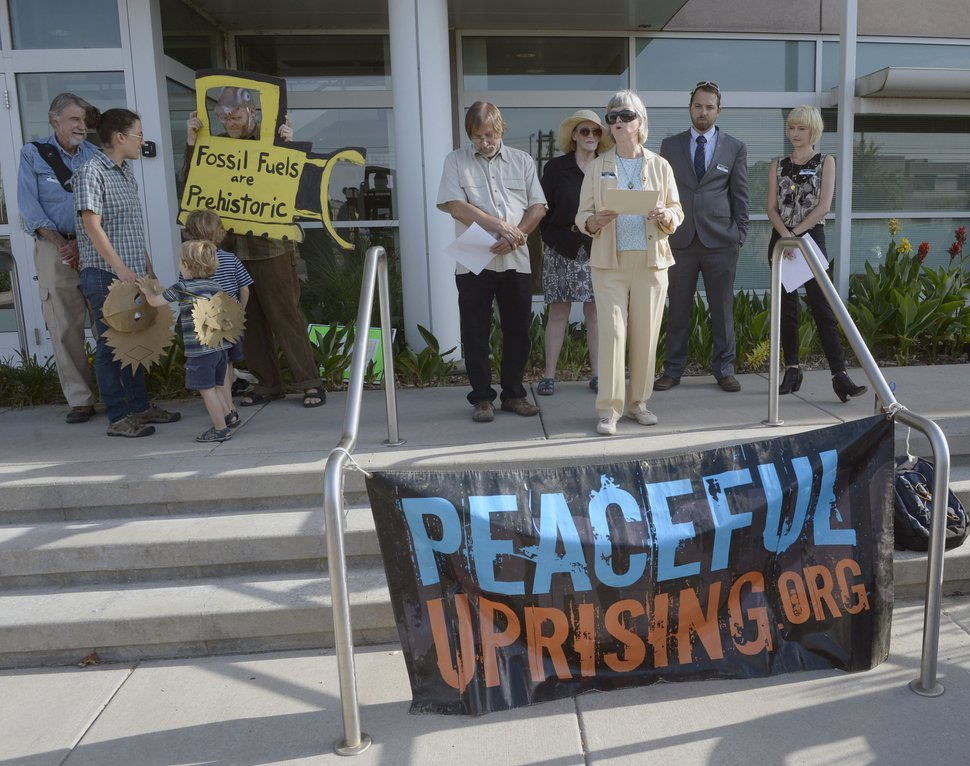 Al Hartmann | The Salt Lake Tribune A small group from Peaceful Uprising and Utah Tar Sand Resistence and concernced citizens read statments and performed a skit on the steps of the Utah Dept. of Natural Rescources before a crucial hearing Tuesday June 30 at the Utah Board of Oil, Gas and Mining in Salt Lake City.