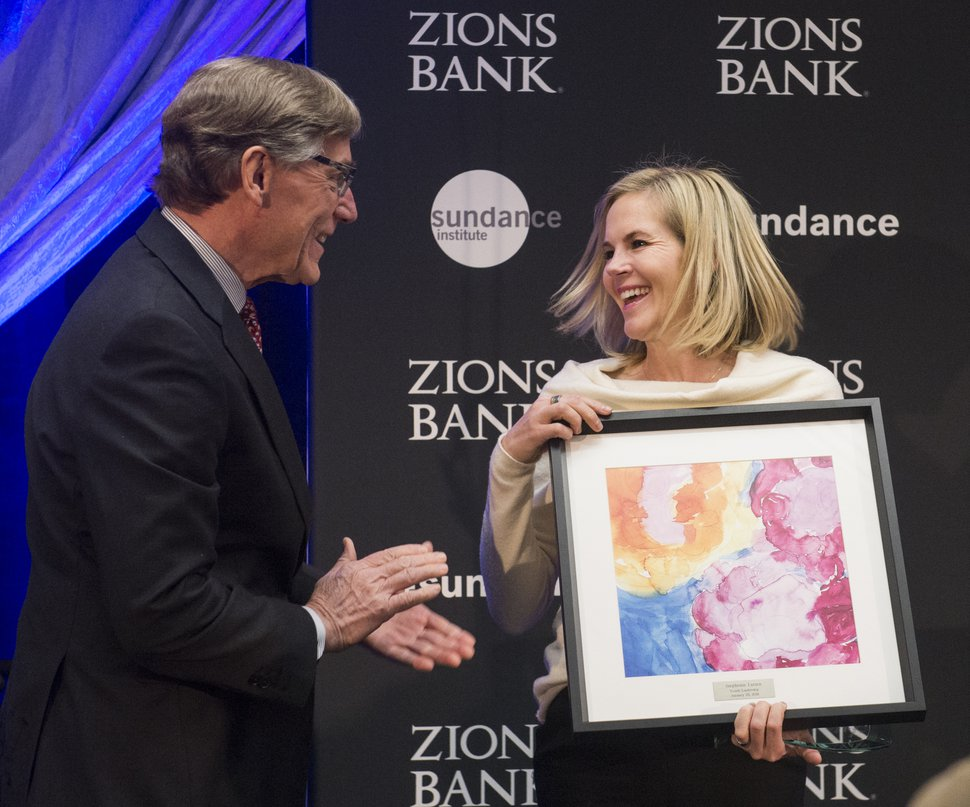 (Rick Egan | The Salt Lake Tribune) Stephenie Larsen, founder of Encircle House, receives a leadership award from Scott Anderson, President and CEO of Zions Bank, at the 2018 Sundance Film Festival Utah Women's Leadership Celebration in Park City, Thursday, January 25, 2018.