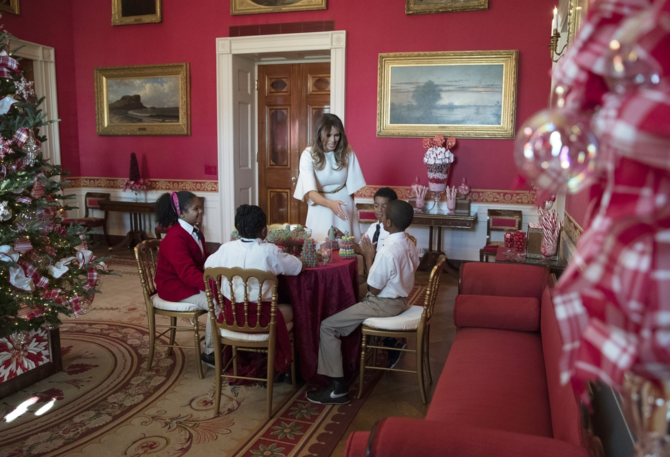 first lady melania trump visits with children in the red room working on holiday treats among