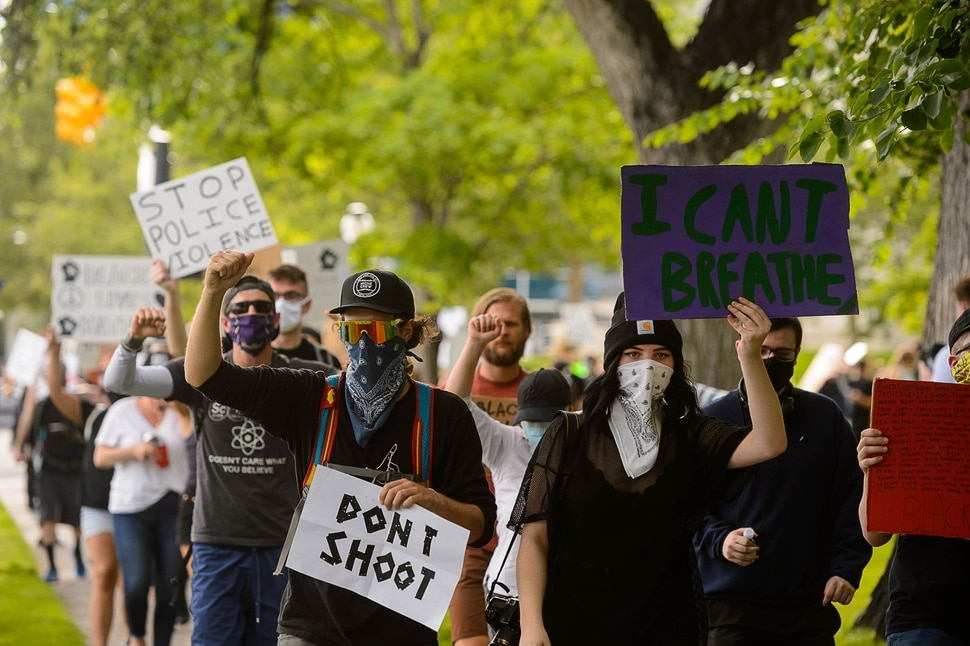(Trent Nelson | The Salt Lake Tribune) Protesters march around City Hall in Salt Lake City on Tuesday, June 2, 2020.