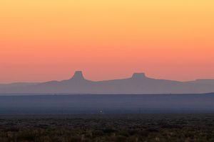 (Megan Marples/Cronkite News via AP) The sun rises over the Navajo Nation Reservation on Sept. 24, 2020, near Pinon, Ariz. The COVID-19 death rate on the reservation, the size of West Virginia, has been greater than that of any U.S. state.