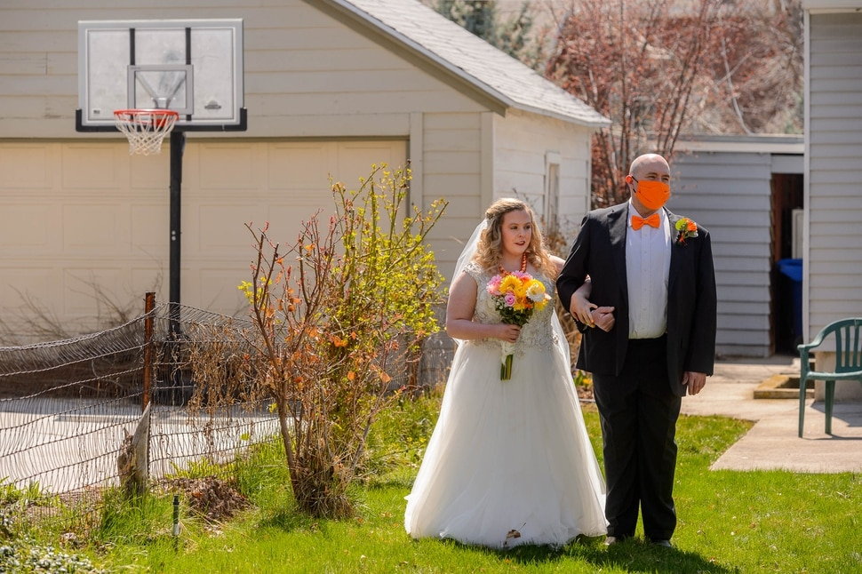 (Trent Nelson | The Salt Lake Tribune) Kadie Smeding prepares to walk the aisle and marry her fiance Tyler van Roosendaal in a Salt Lake City yard on Saturday, April 4, 2020.