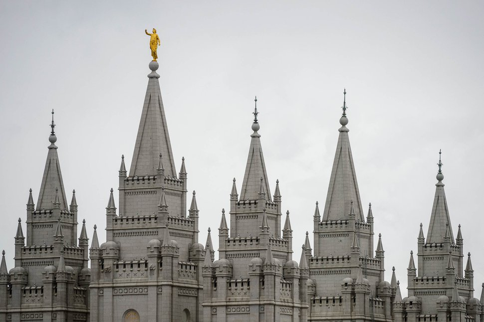 (Trent Nelson | The Salt Lake Tribune) The statue of Moroni, atop the Salt Lake Temple, lost its horn in an earthquake Wednesday, March 18, 2020.