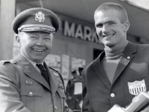 Photo courtesy of the Alf Engen Museum   Bill Spencer shakes the hand of a military official while wearing an International Military Sports Council jacket circa 1960. Spencer, a two-time U.S. Olympic biathlon athlete and U.S. Army officer, died Thursday, Dec. 3, 2020, at age 84.