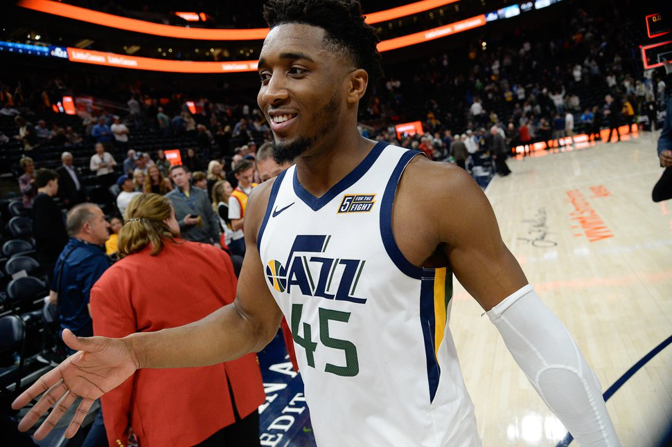 (Francisco Kjolseth | The Salt Lake Tribune) Utah Jazz guard Donovan Mitchell (45) is all smiles as he celebrates their 100-95 home opener win against the Oklahoma City Thunder in their NBA basketball game at Vivint Smart Home Arena in Salt Lake City on Wed. Oct. 23, 2019.
