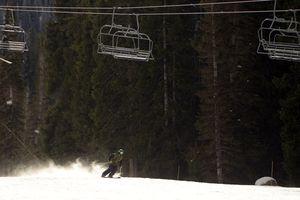(Rick Egan | The Salt Lake Tribune) A makes his way down the slopes, under the Majestic ski lift, at Brighton Ski Resort, Thursday, November 19, 2015. Alta, Snowbird, and Solitude ski resorts open this weekend.